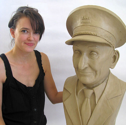artist Stephanie Hunter with a custom clay sculpture